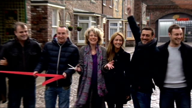 "new set for ""coronation street""; england: manchester: salford quays: ext stars of soap opera coronation street curtting ribbon to open new set stars... - soap opera stock videos & royalty-free footage"