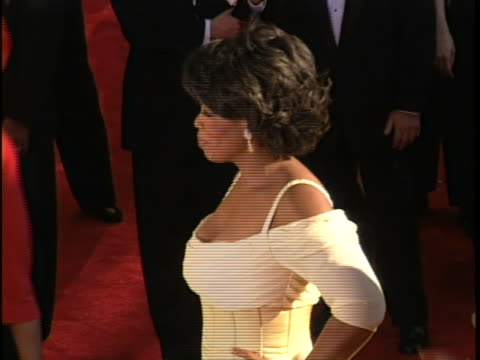 television personality talk show host, oprah winfrey seen wearing ivory corseted gown on the red carpet at the 2002 emmy awards. - emmy awards stock videos & royalty-free footage