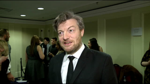 rts programme awards 2013 interviews charlie brooker interview sot / charlie brooker as interviewed by press / sheridan smith chatting to press - sheridan smith stock videos & royalty-free footage
