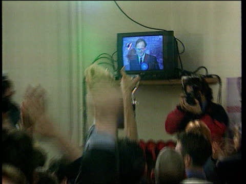 INT MV Television screen showing Malcolm Rifkind on election night PULL OUT Labour supporters celebrating winning seat SLOW MOTION Rifkind on stage...
