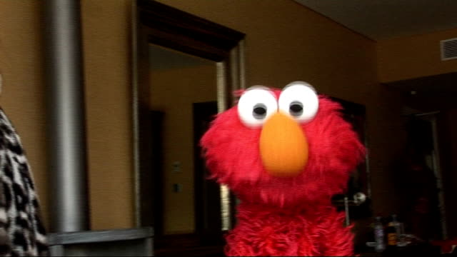 sesame street puppet elmo interview sings single ladies / likes all the celebrities he has met / misses his pet goldfish - puppet stock videos & royalty-free footage