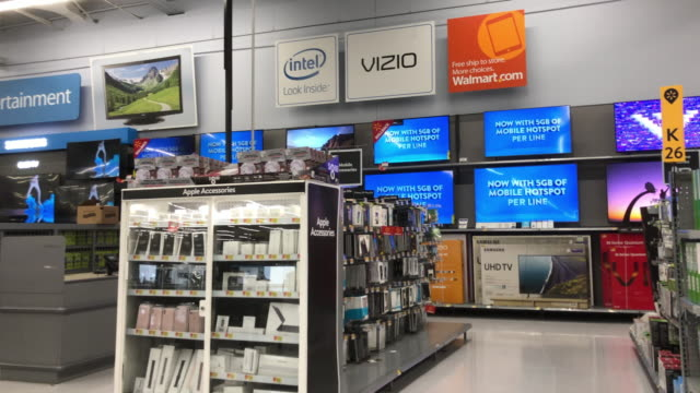 television set and apple devices are on sale at the walmart superstore shopping center in north georgia, usa - electrical equipment video stock e b–roll