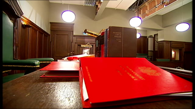 television set courtroom interiors; legal books / legal documents / books and files on table in courtroom / courtroom seen from dock / view into... - gesamtansicht stock-videos und b-roll-filmmaterial