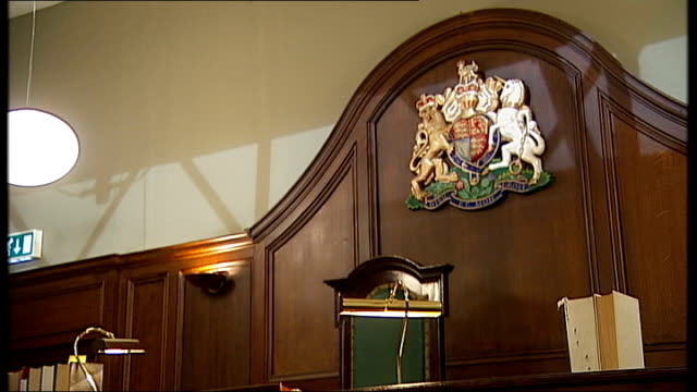 television set courtroom interiors; tracking shots around empty courtroom with wigs and documents on tables and judges bench with royal crest above /... - court room stock videos & royalty-free footage