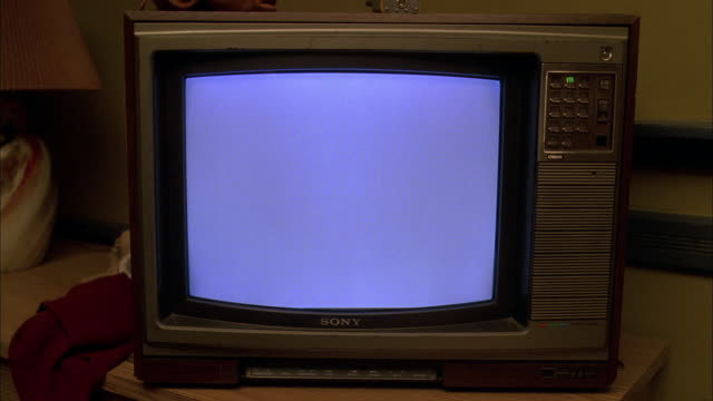 CU Television set on a desk turned on