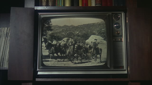 vídeos de stock e filmes b-roll de ms television set showing an old western movie - fora de moda estilo