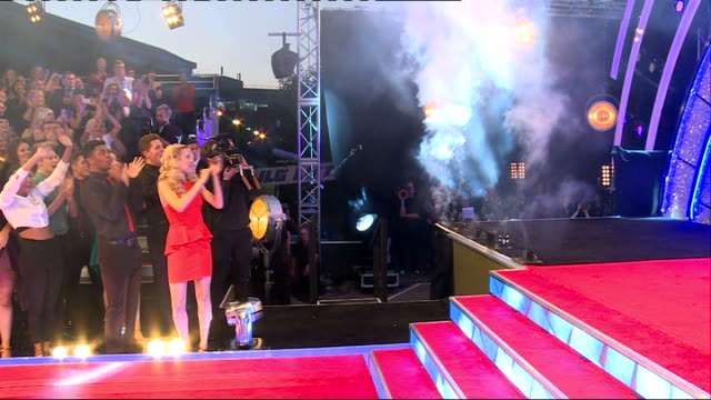 strictly come dancing 2014 launch: launch and interviews; fireworks on stage and audience applauding arrival of celebrity guests including greg... - ストリクトリーカムダンシング点の映像素材/bロール