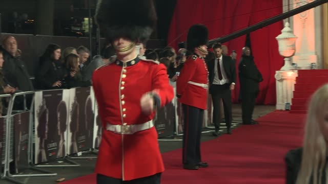 'The Crown' red carpet event Red carpet soldiers marchingclips from tv show being played / Actor Jared Harris arriving with wife / Director Stephen...