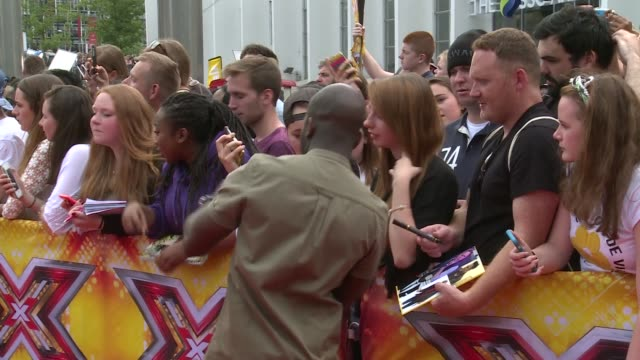 the x factor 2015 launch at wembley arena; england: london: wembley arena: ext fans behind barriers / melvin odoom signing autographs / melvin odoom... - wembley arena stock videos & royalty-free footage