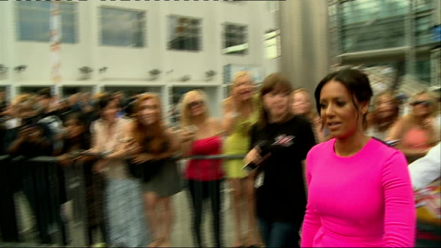 the x factor auditions in london; mel b posing with fans / mel b interview sot - the x factor stock videos & royalty-free footage