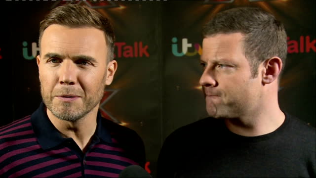 the x factor prefinal interviews england london int nicole scherzinger and gary barlow talking to other press / gvs barlow preapring for interview... - nicole scherzinger stock videos and b-roll footage