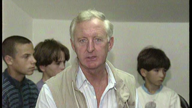veteran itn correspondent michael nicholson dies aged 79 t14079201 / tx news reporter michael nicholson report to camera in orphanage/ young girl in... - orphanage stock videos and b-roll footage