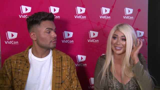 vidcon london 2019: gvs / 'geordie shore' interviews; england: london: excel centre: nathan henry and chloe ferry interview sot - リアリティー番組点の映像素材/bロール