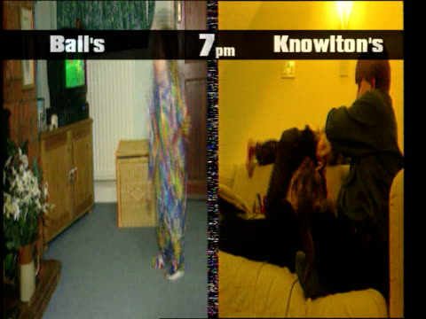 television watching; james knowlton sitting next fire as small girl walks up to him and he picks her up split screen seq: comparison between evening... - bericht film und fernsehen stock-videos und b-roll-filmmaterial