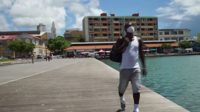 """stockvideo's en b-roll-footage met telling us not to go to the seaside or to the river between noon and two p.m. is something quite surprising"""": in guadeloupe, inhabitants and local... - franse overzeese gebieden"""