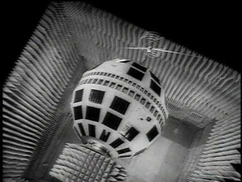 telstar satellite spinning on display at bell telephone laboratory / hillside new jersey united states - telstar stock-videos und b-roll-filmmaterial