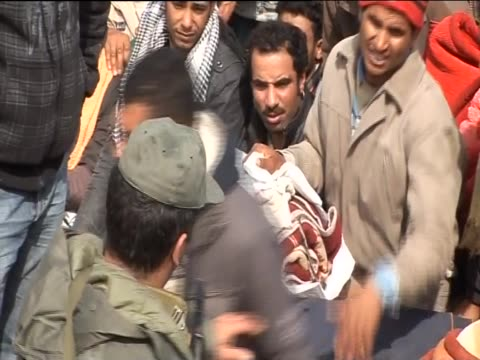 tempers fray between people waiting between the tunisia and libya border during the libya uprising - revolution stock videos & royalty-free footage
