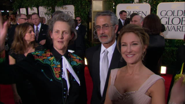 temple grandin, david strathairn & emily gerson saines waving & posing for paparazzi on the red carpet at the beverly hilton hotel - the beverly hilton hotel stock videos & royalty-free footage