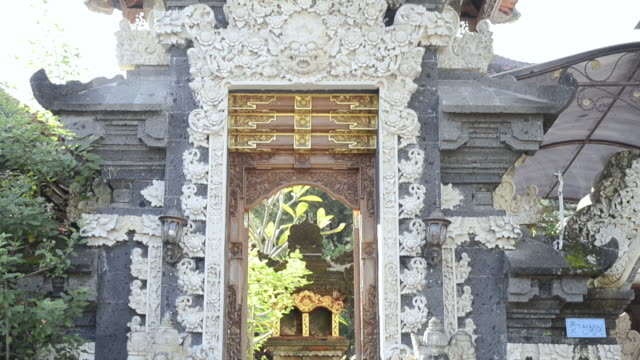 ms td temple guardian in front of house entrance door like temple / ubud, bali, indonesia    - ubud district stock videos & royalty-free footage