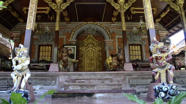 ms temple guardian in front of palace puri saren / ubud, bali, indonesia - ubud district stock videos & royalty-free footage