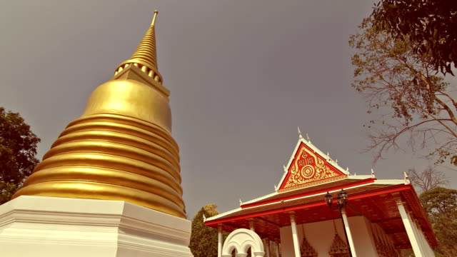 temple in thailand, time lapse vintage style. - golden roof stock videos and b-roll footage