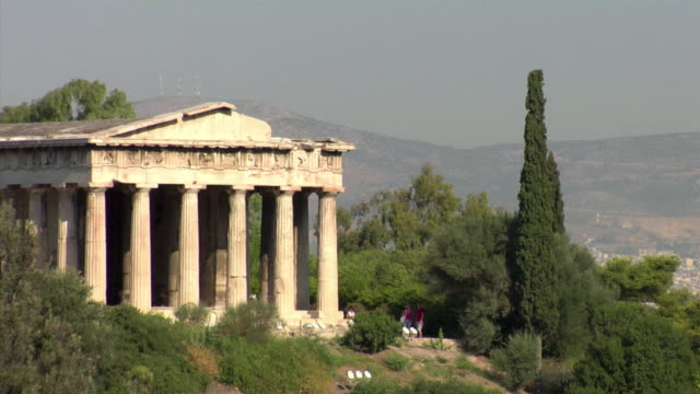 2008 MS Temple of Hephaistos surrounded by vegetation / Tourists at base / Athens, Greece