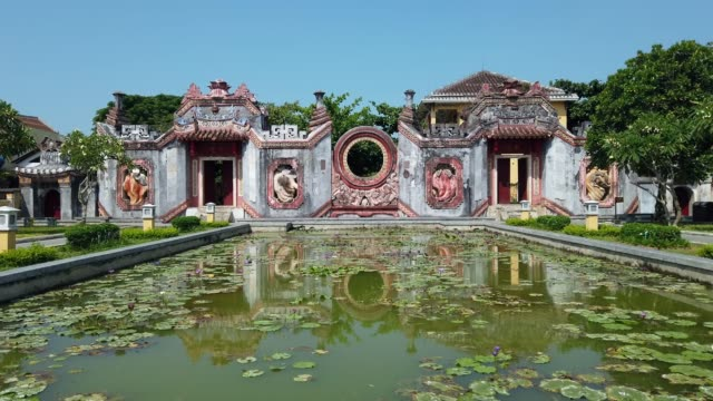 temple of mother (chua ba mu) in hoi an, vietnam. hoi an is noted since 1999 as a unesco world heritage site. - temple building stock videos & royalty-free footage