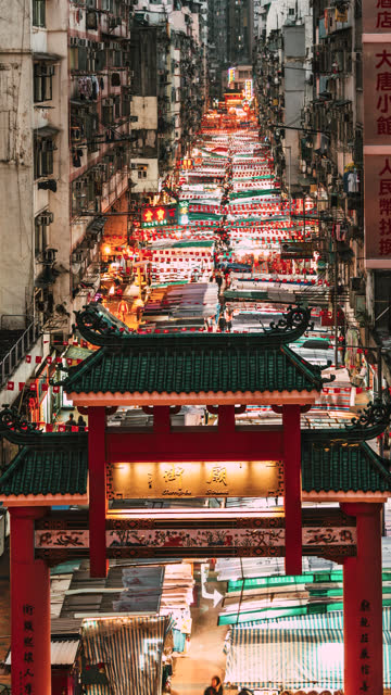 t/l pan temple street night market at dusk / hong kong - mong kok stock videos & royalty-free footage