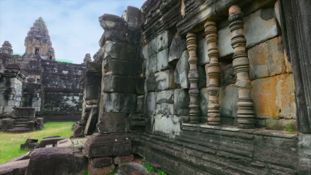 temple walls and sky with green grass land - angkor wat stock videos and b-roll footage