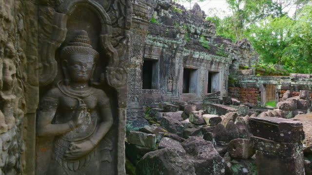 temple with rock statue - angkor wat stock videos and b-roll footage