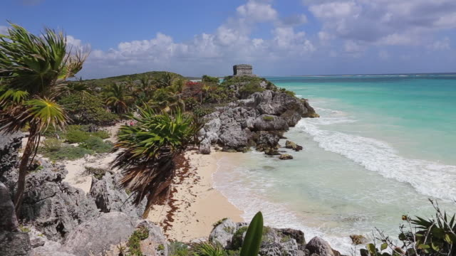 templo dios del viento ( temple of the god of wind ) guarding tulum's sea entrance bay - old ruins of mayan walled city of tulum in mexico / yucatán peninsula - pre columbian stock videos & royalty-free footage