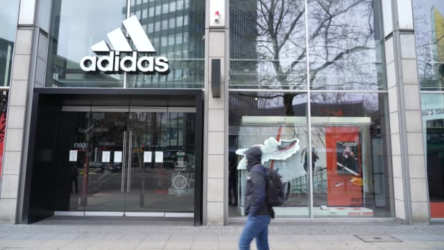 temporarily closed adidas store stands in the city center during the coronavirus crisis on april 15, 2020 in berlin, germany. as the rate of new... - adidas stock videos & royalty-free footage