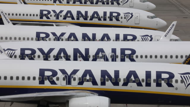 temporarily out of service ryanair passenger aircrafts on runway at stansted airport essex uk on friday may 1 2020 - ライアンエアー点の映像素材/bロール