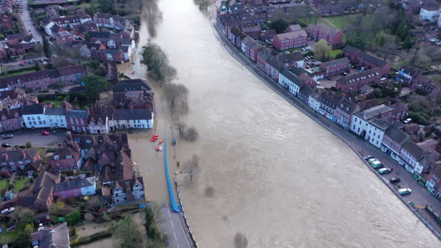temporary flood barriers are overwhelmed by flood water from the river severn on february 26 2020 in bewdley england shrewsbury worcester and... - drone stock videos & royalty-free footage