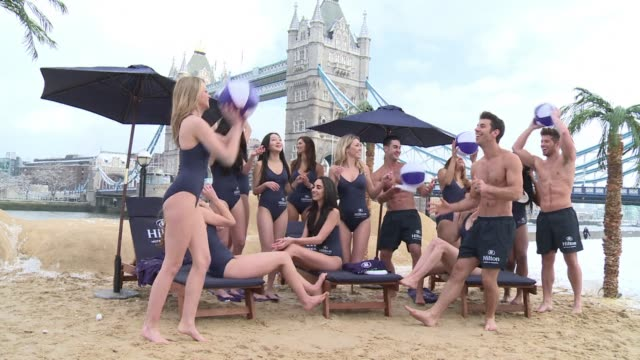 temporary holiday resort beside london iconic tower bridge is offering the city snow bound residents a chance to take a mini vacation.. clean : beach... - temporary stock videos & royalty-free footage