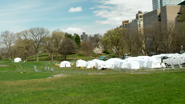 a temporary hospital built by samaritan's purse an evangelical christian humanitarian aid organization on the east meadow lawn of manhattan's central... - makeshift stock videos & royalty-free footage