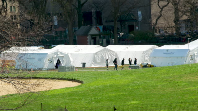temporary hospital built by samaritan's purse - an evangelical christian humanitarian aid organization - on the east meadow lawn of manhattan's... - temporary stock videos & royalty-free footage
