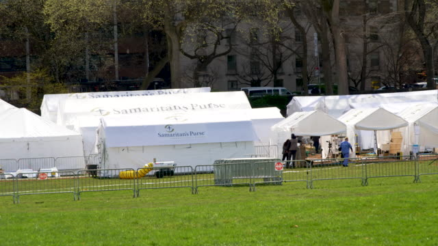 a temporary hospital built by samaritan's purse an evangelical christian humanitarian aid organization on the east meadow lawn of manhattan's central... - evangelicalism stock videos & royalty-free footage
