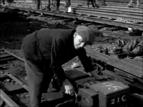 temporary signal box in operation at cannon street; england: london: cannon street: int ** library music overlaid sot ** signalman pulling switches... - manual worker stock videos & royalty-free footage