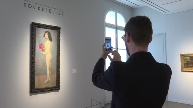 ten artworks from the rockefeller collection are exhibited at christie's france including young naked girl with flower basket by pablo picasso before... - versteigerung stock-videos und b-roll-filmmaterial