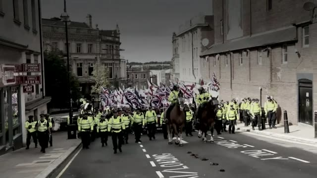 ten asian men cleared of violent disorder over clashes in rotherham lib shots of far right protesters along with police escort - rotherham stock videos & royalty-free footage