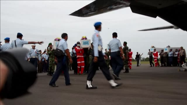 ten more bodies are flown to surabaya in indonesia after recovery teams narrowed the search area for airasia flight 8501 friday - surabaya stock videos & royalty-free footage