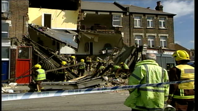 ten people trapped after flats collapse in tottenham itn north london tottenham ext gvs firefighters sorting thru rubble zoom in firefighters sifting... - sifting stock videos and b-roll footage