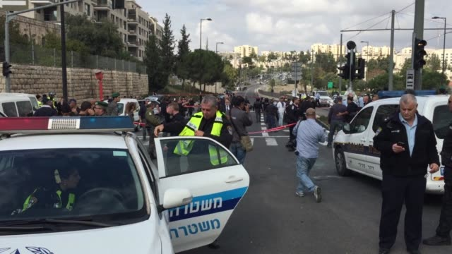 stockvideo's en b-roll-footage met ten people were wounded one critically when a car deliberately rammed pedestrians in jerusalem on wednesday before the driver was shot dead by police... - israëlisch palestijns conflict