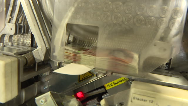 ten pound notes being sorted by machine into bundles at g4s cash processing centre - banknote stock videos & royalty-free footage