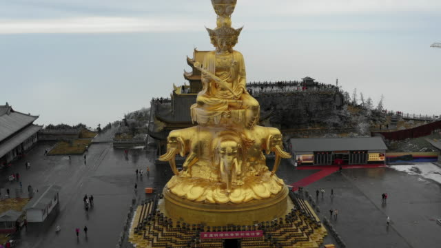 ten sides of puxian statue and buddhist temple on mount emei, chengdu, china - buddha stock-videos und b-roll-filmmaterial