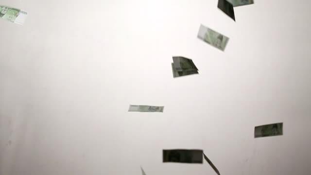 MS Ten thousand Korean won notes falling against white backdrop / Seoul, South Korea