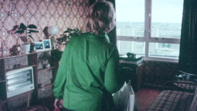 1976 montage tenant entering apartment of tenement high-rise and looking out the window / united kingdom - 1976 stock videos & royalty-free footage
