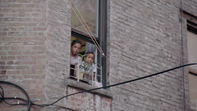 tenants look out from their apartment windows. - tenant stock videos & royalty-free footage