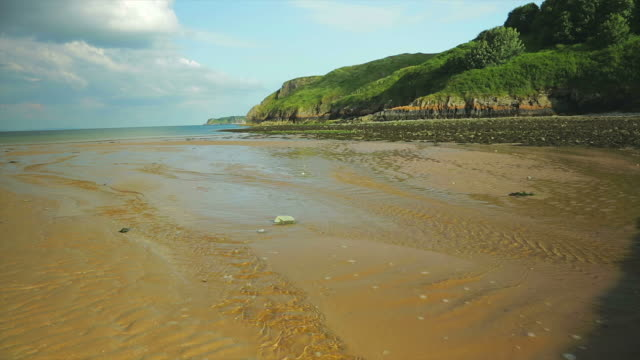 tenby beach in south wales at low tide. - low tide stock videos & royalty-free footage